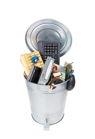different computer parts in trash can