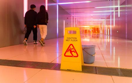 """""""Caution wet floor"""" sign in underpass"""