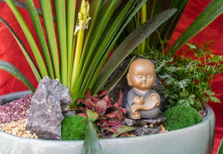 Figure of Little Monk Beside the Flower Pots