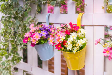 Hanging Flower Pots with fence 免版税图像