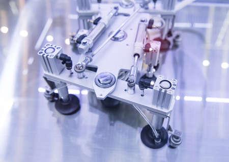 robotic pneumatic piston sucker unit on industrial machine,automation compressed air factory production 免版税图像