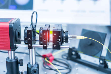 Experiment with laser device in optical laboratory Stock fotó