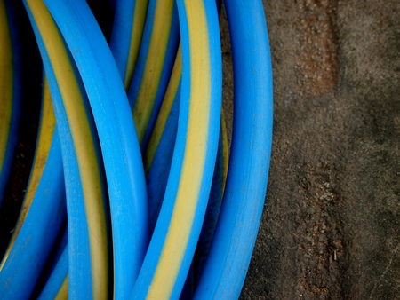 vibrant color rubber tubing on grunge concrete surface