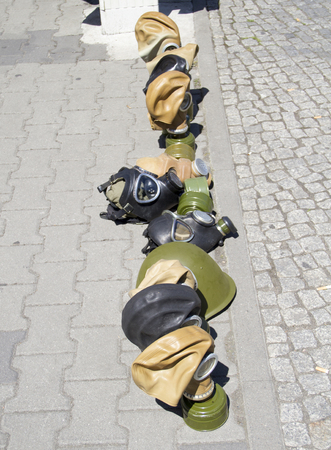 gas masks in a flohmarkt in Berlin Archivio Fotografico - 118444537