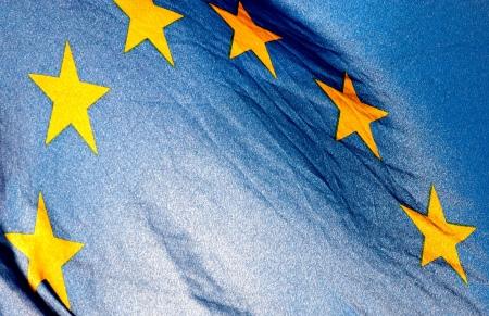 horisontal:  Fragment of the European Union Flag waving in in backlit sunlight