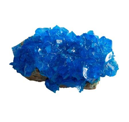 Blue mineral chalcanthite (copper sulfate) on stone on a white background Standard-Bild