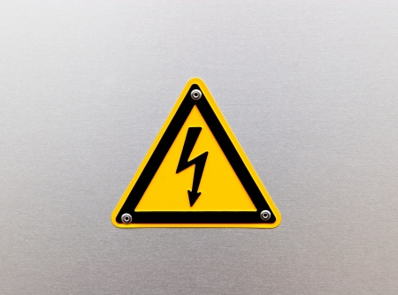 High voltage sing on the metal background photo