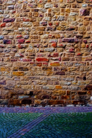 pave:  Multicolored stone wall and pavement