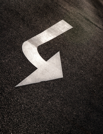 Arrow sign as road markings on a street  Stock Photo - 21249529