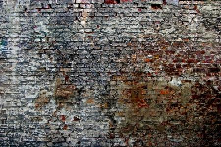 A old dilapidated brick wall Standard-Bild