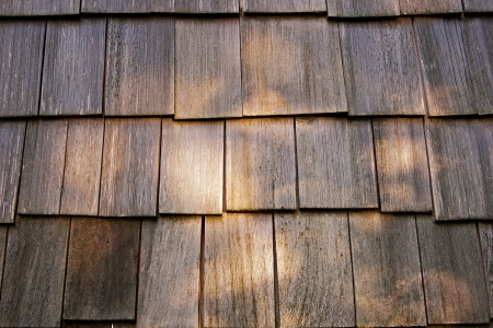 roof shingles: Wooden tile on the roof of a house Stock Photo