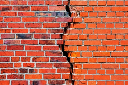 A brick wall with a crack photo