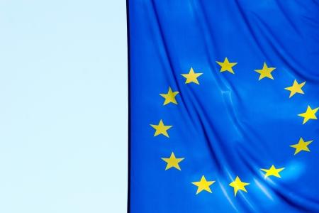 A fragment of EU flag against the sky photo
