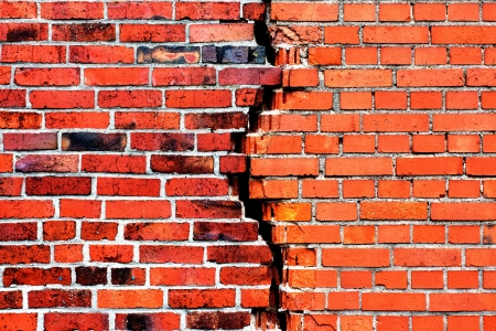 Background of brick wall with crack photo