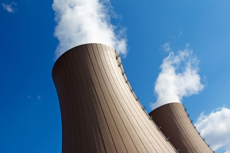 npp: Cooling towers of  nuclear power plant against sky and clouds Stock Photo