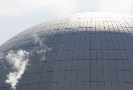 Fragment of dome of  nuclear reactor of nuclear power plant and smoke Stock Photo - 21272642