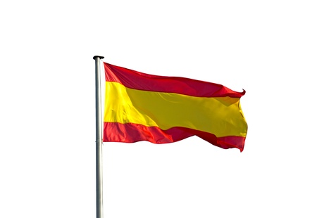 Spanish flag in the wind on a white background photo