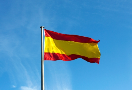 Spanish flag in the wind against the sky photo