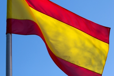 Spanish flag on a background of blue sky photo