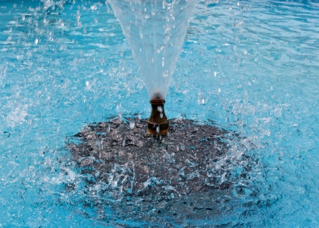 splutter: Water spray of fountain on a turquoise background Stock Photo