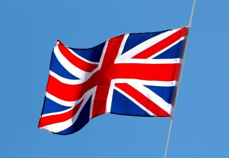 drapeau anglais: Drapeau anglais dans le vent contre le ciel