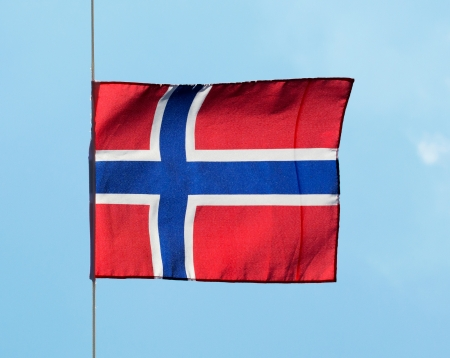 icelandic flag: Bandera islandesa en el viento contra el cielo Foto de archivo