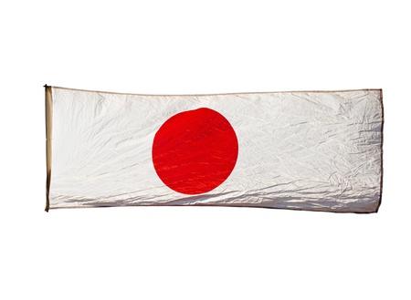 bandera japon: Bandera japonesa aislada en el viento contra el cielo