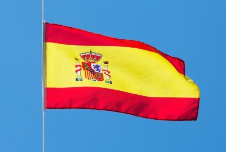 Spanish flag in the wind against the sky Standard-Bild