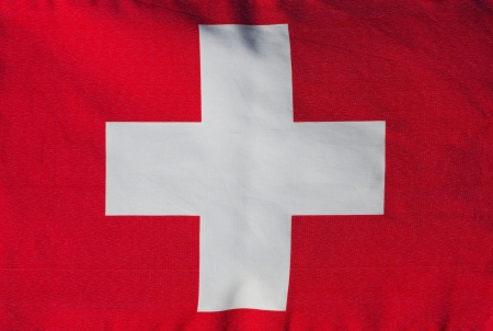 Swiss flag in the wind close-up photo