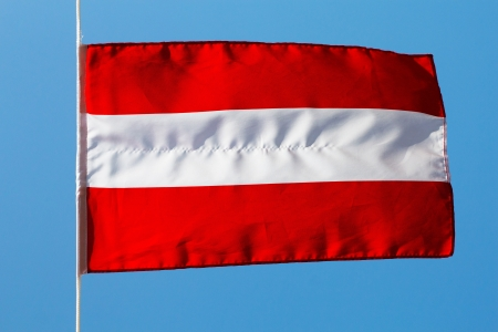 Austrian flag in wind against the sky photo