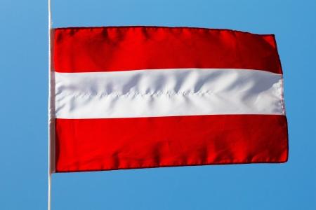 Austrian flag in wind against the sky photo