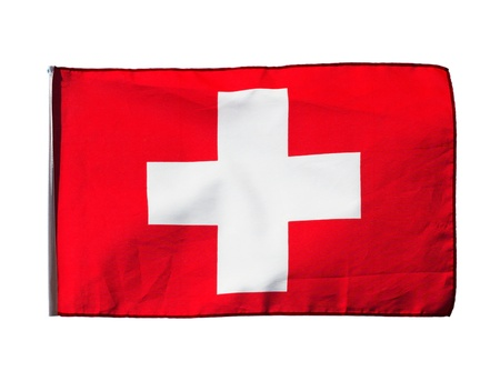 Swiss flag in the wind on a white background photo