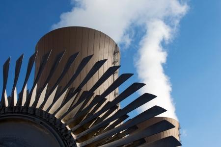 Steam turbine against nuclear power plant.Conceptual image of nuclear energy Standard-Bild