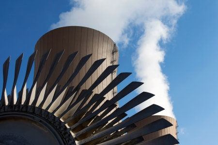 generating station: Steam turbine against nuclear power plant. Conceptual image of nuclear energy Stock Photo