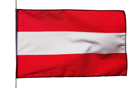 Austrian flag in wind on a white background photo