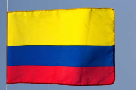 colombian flag: Colombian flag in the wind against the sky Stock Photo