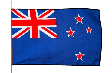 New Zealand flag in the wind on white background photo