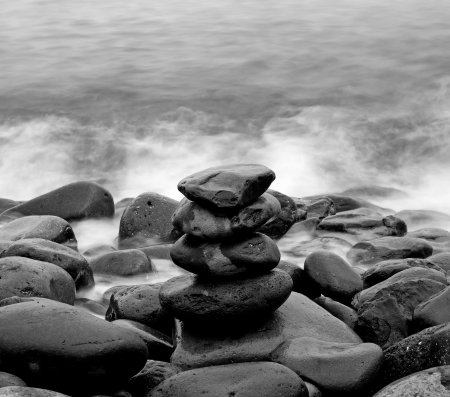 Pile of round smooth stones on a seashore