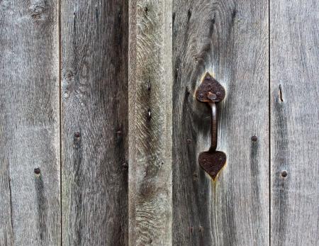 doorhandle: Rusty door handle  of wooden door Stock Photo