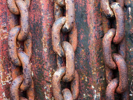 Old rusty chains on a rotor photo