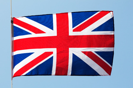 English flag in the wind against a sky photo