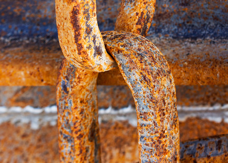 Old and rusty chain close up photo