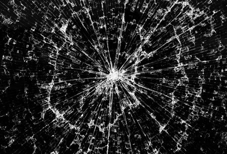 Background of black broken glass in the cracks
