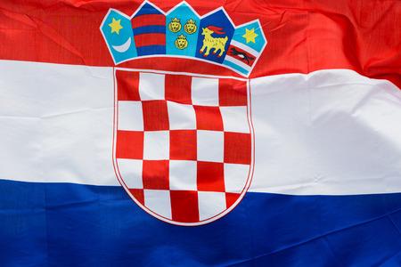 Croatia flag in the wind in the sunlight photo