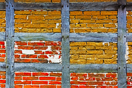 Old adobe and brick wall of the half timbered house photo