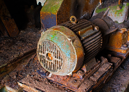 Old electric motor in an abandoned factory photo