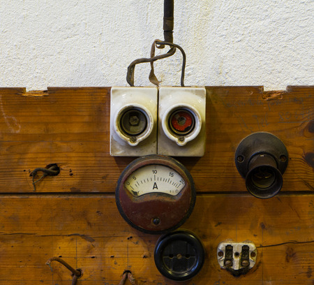 dado: Measuring device socket and fuse on a wooden panel