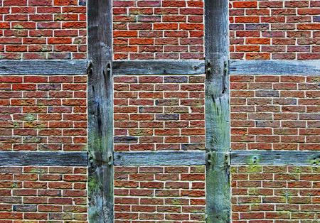Brick wall of the half timbered house photo