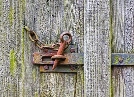deadbolt: The iron latch on a wooden door Stock Photo