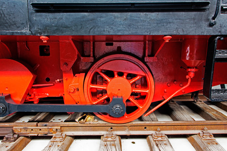 Part of the old locomotive on the rails photo
